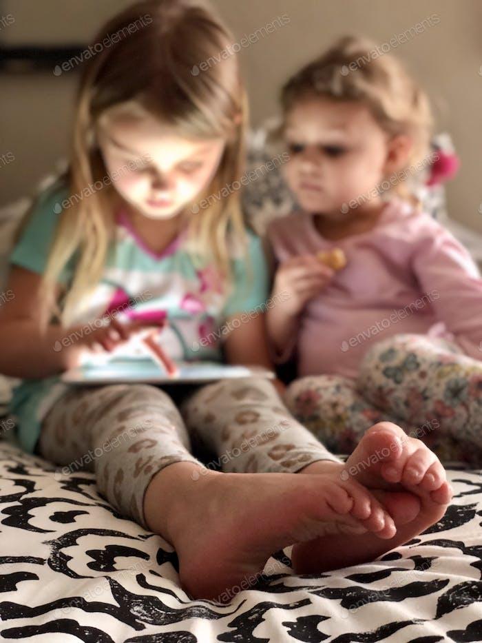 Little girls using technology.  iPad, tech, digital
