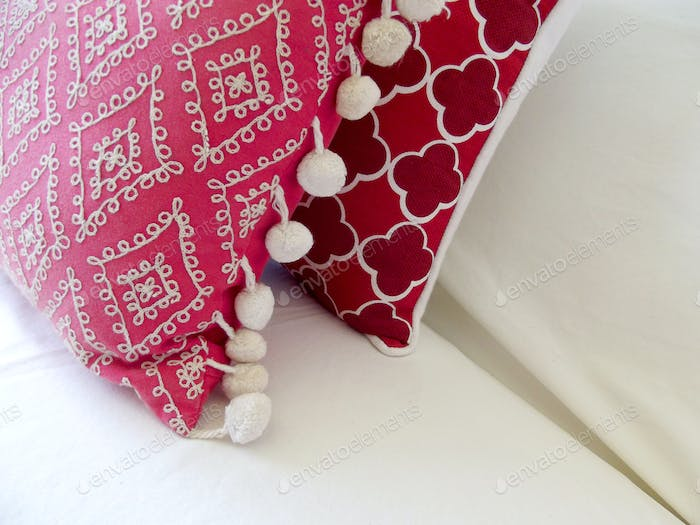 Red cushions on a sofa