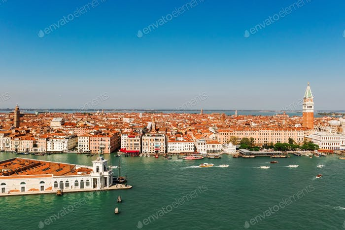 Aerial shot of Venice city and Grand Canal, Italy. View from above. Tiled roofs and nerros streets.