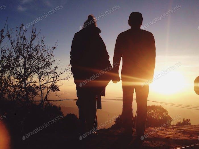 Couple and sunrise