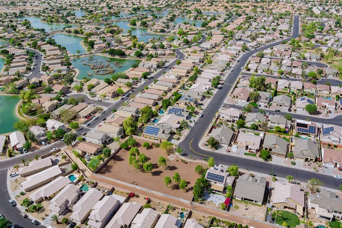 Aerial overlooking small desert small town a Avondale city of rugged mountains near of Phoenix Ariz