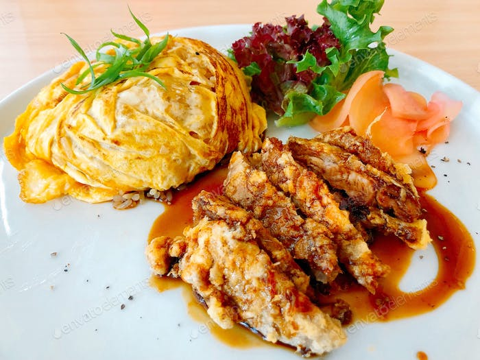 Crispy fried duck in teriyaki sauce served with thin omelette over white rice