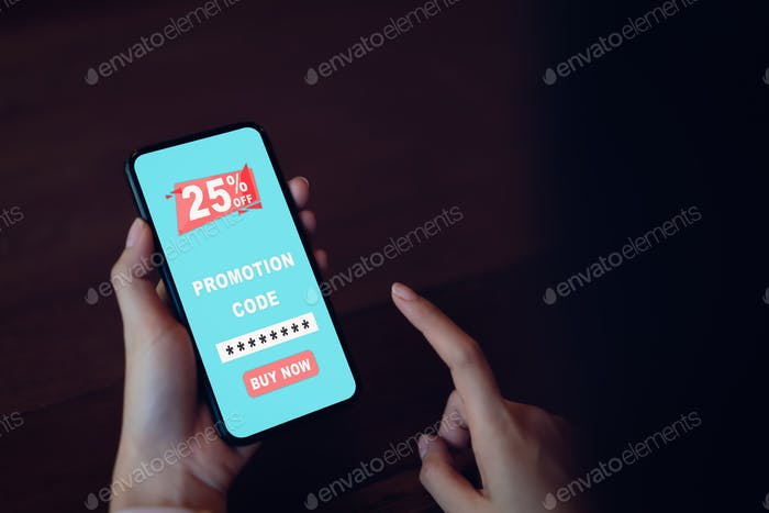 Woman holding smartphone to enter the code to get a discount from the store