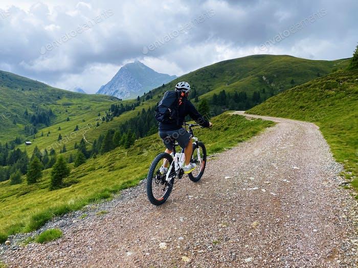 Single mountain bike rider on electric bike