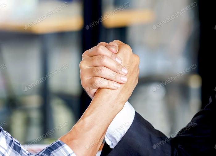 two hands holding on business deal