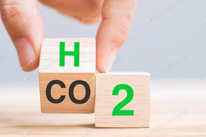 hand flipping blocks with CO2 (Carbon dioxide), change to H2 (Hydrogen) text. Free Carbon concepts