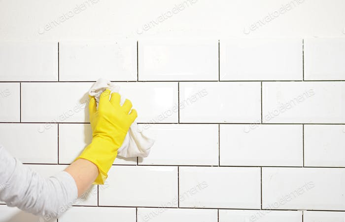 finishing the tiling of the kitchen with white tiles