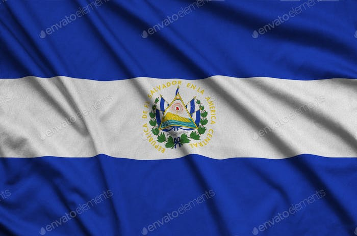 El Salvador flag  is depicted on a sports cloth fabric with many folds. Sport team waving banner