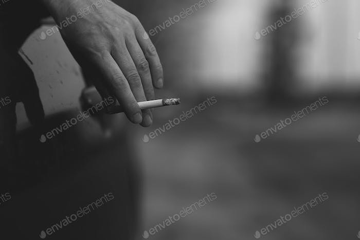Hand of woman with cigarette
