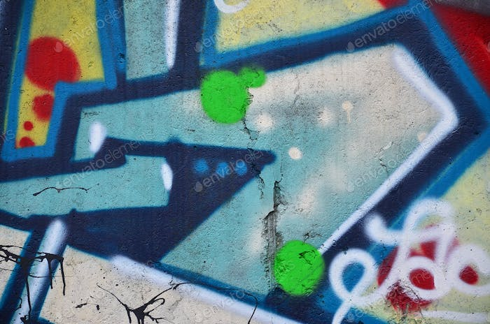 Texture of a fragment of the wall with graffiti painting, which is depicted on it