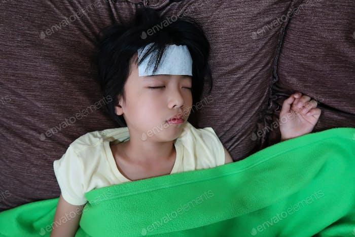 Asian little girl has a fever