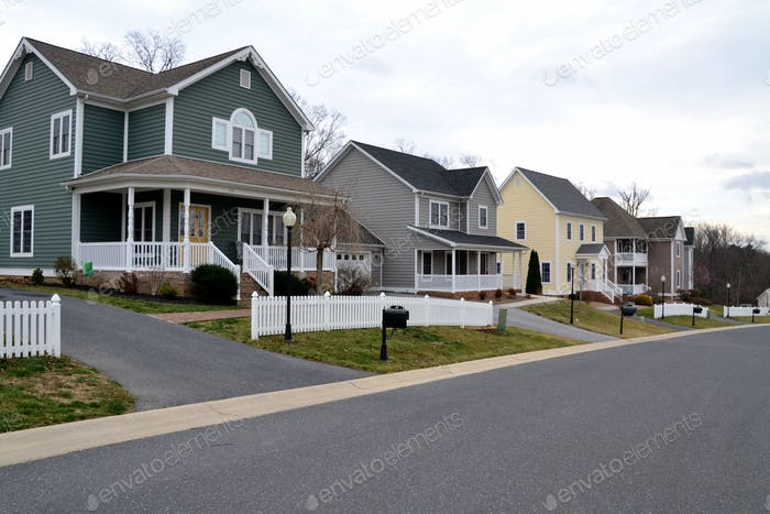 A street of modern homes houses in various colors to make a cozy neighborhood of prime real estate