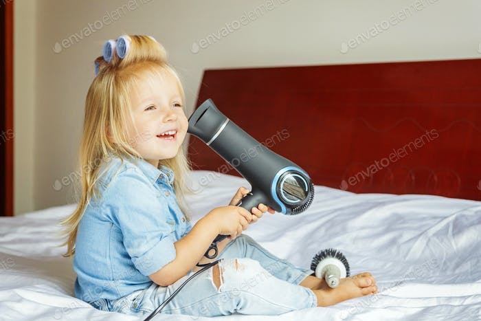 ⭐️⭐️⭐️ Nominated ⭐️⭐️⭐️ cute little girl with white hair in hair curlers sitting at home on the bed