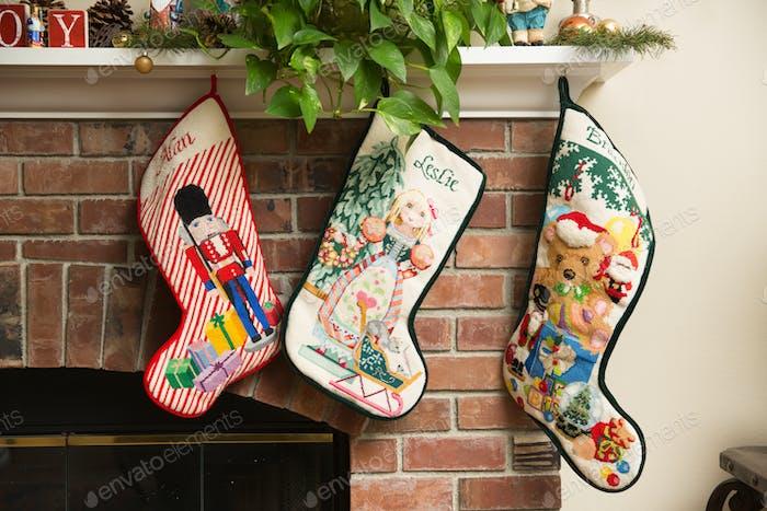Handmade Christmas stockings hanging on the mantel