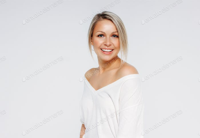 Blonde hair sensitive smiling woman 35 year plus close up beauty portrait isolated on white