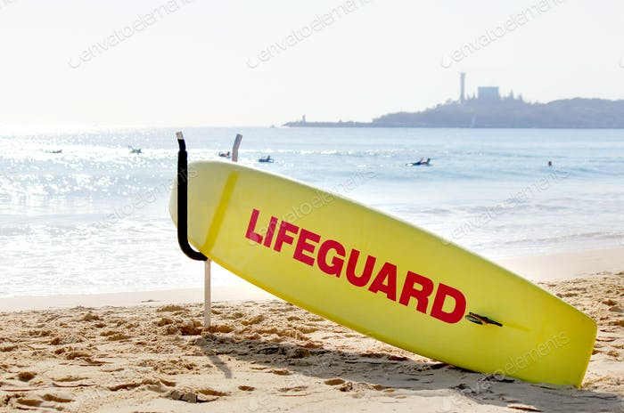 Lifeguard station and surfboard on the beach