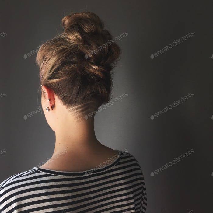 Back view of a young woman's undercut.