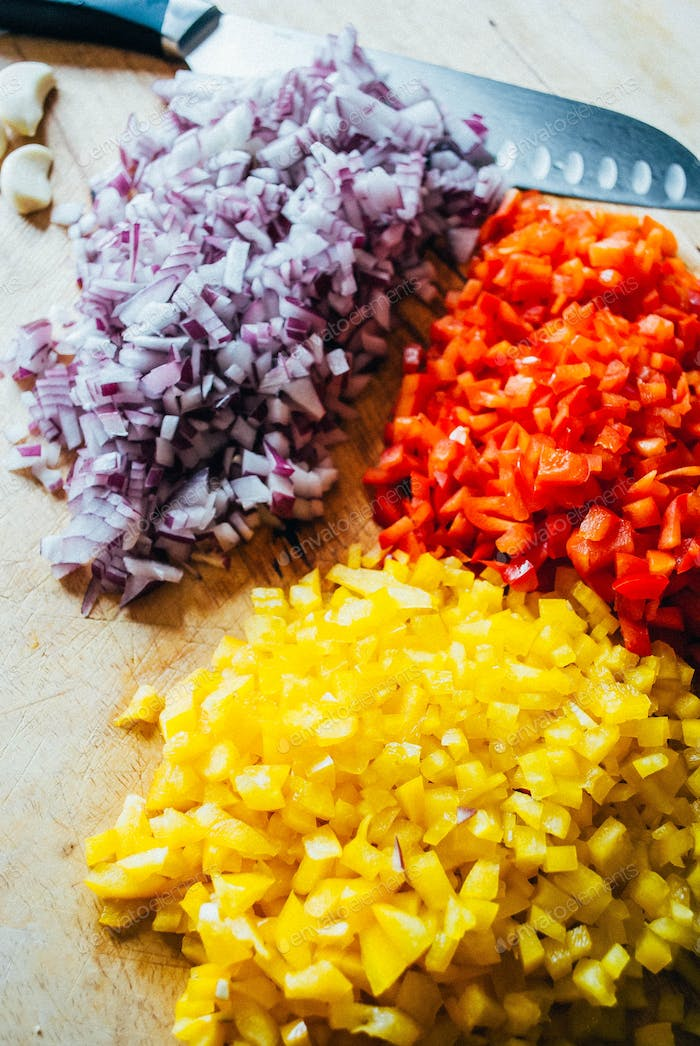 Chopped vegetables on wooden chopping board