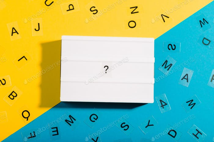 Question mark on light box, flat lay with duo color blue and yellow background, question to answer