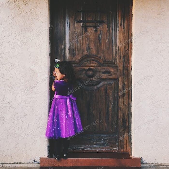 Girl in purple at front door