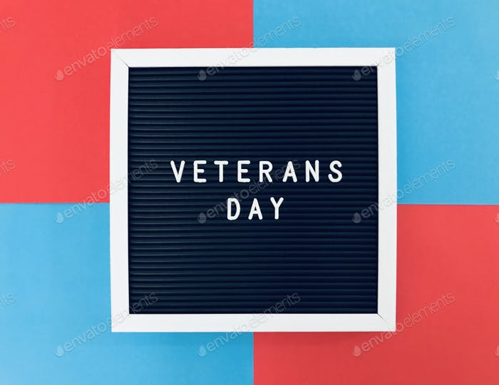 Veterans Day sign board on blue and red background to salute our dearest veterans