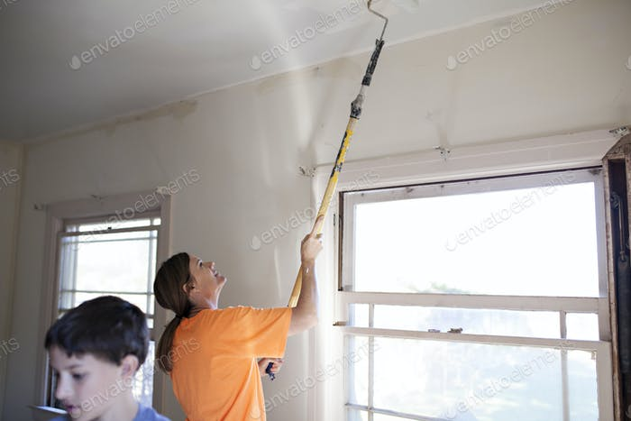 Woman painting a ceiling
