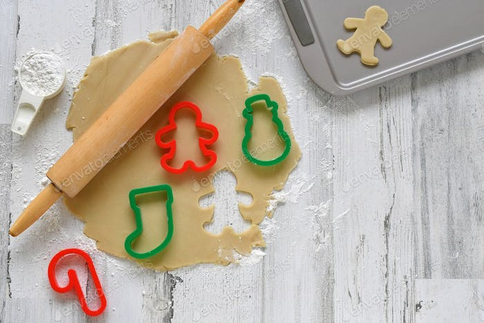 Baking Christmas cutout cookies with colorful stocking candy cane cookie cutters gingerbread man