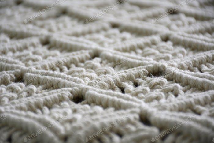 Close-up handmade macrame carpet texture. Interior decor.   Nominated!