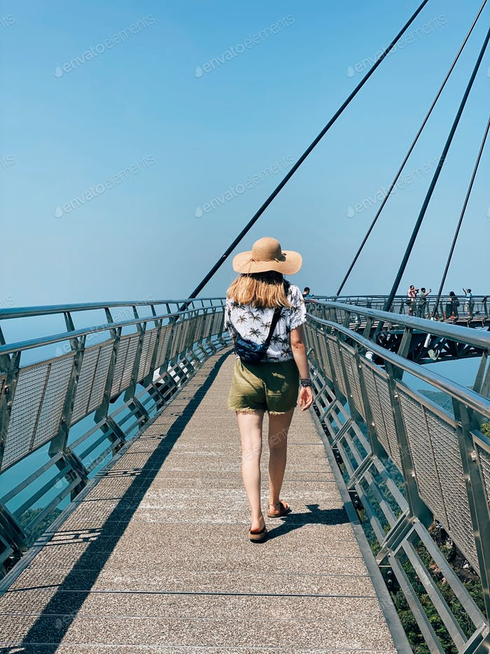 young woman, adult, people from behind, straw hat, summer style, blue sky, day, tropical climate, wa