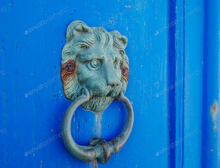 Vintage old door handle on blue doors. Knock, knocking, door, doors, blue.
