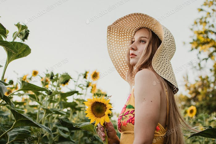 Slow Living concept New Lifestyle Trend. Relaxing young woman with lowers in nature