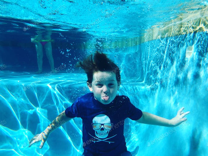 Little boy under water in the pool