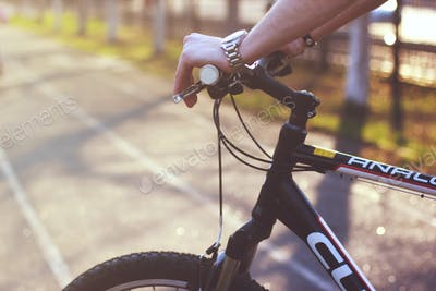 Men's hand on the bicycle