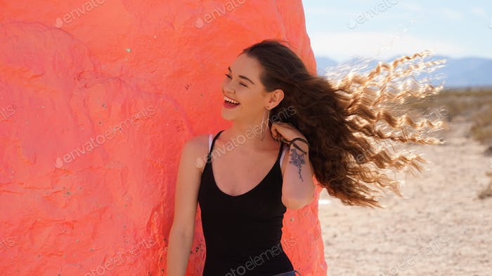 Laughing girl with her hair blowing in the wind