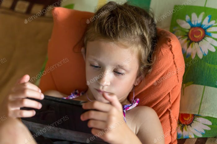 *NOMINATED ON OCT 30 BY M* 6 years old girl watching cartoons on a tablet at home