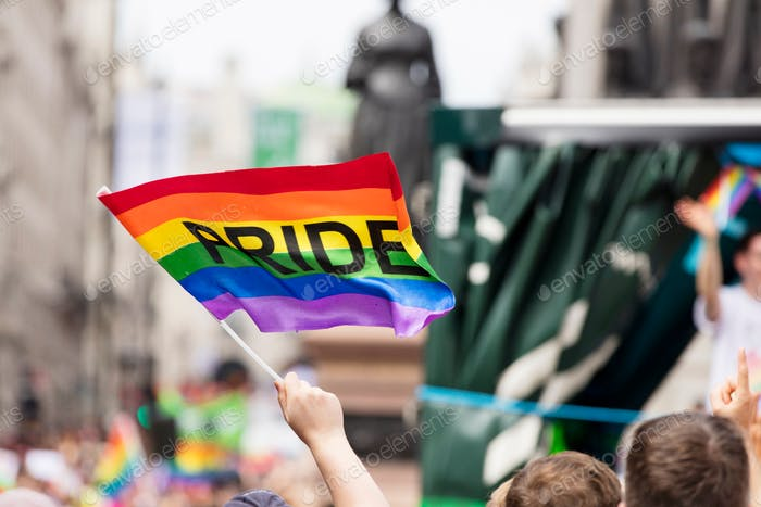 LGBT rainbow flag waved at a pride march