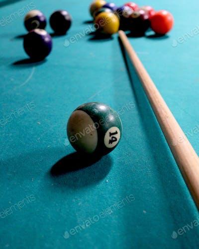 Playing snooker , playing pool