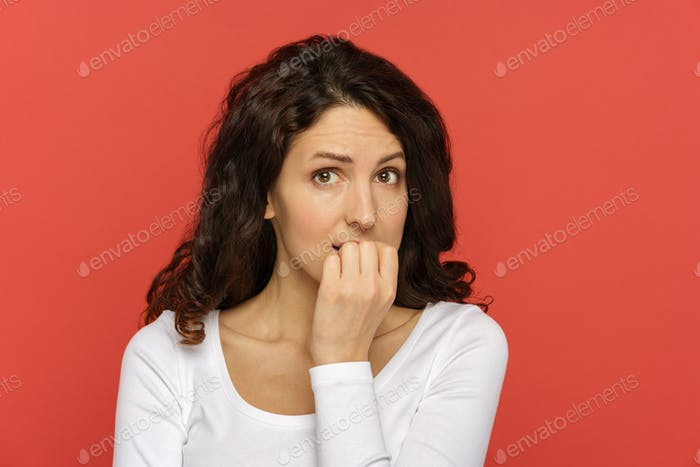 Worried young woman scared in stress biting nails get in trouble, problem afraid think of solution