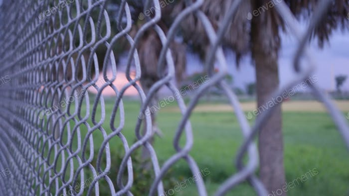 Closeup View Next To A Chainlink Fence's Diminishing Perspective