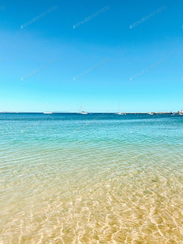 Beach view at Praia de Rainha Cascais Lisbon. Summer in Europe