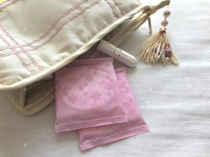 Women 's Health : Menstruation. Sanitary pads and a tampon in a wash-bags