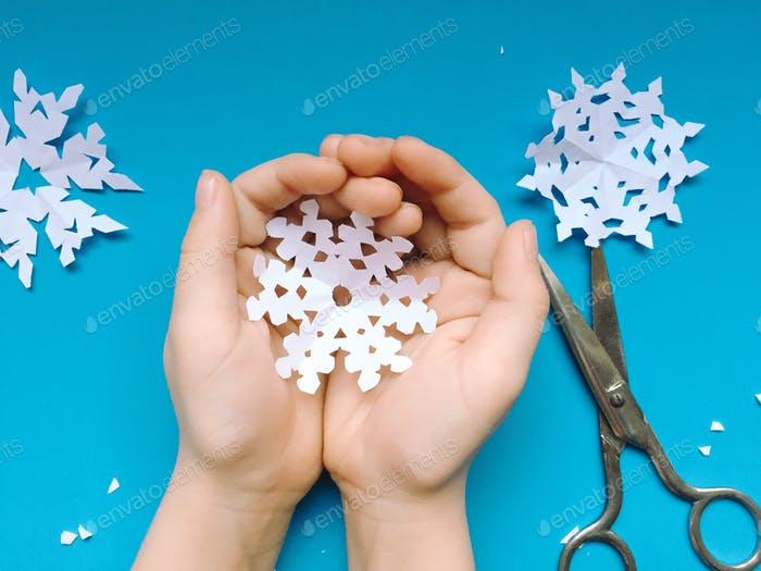Paper Snowflakes on Pale Blue
