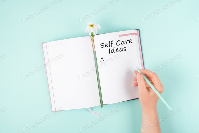 Self Care, wellbeing Routine, holistic set of self-care activities concept with open notebook