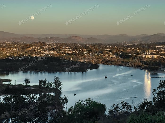 Sweeping view of San Diego neighborhoods under a full moon.