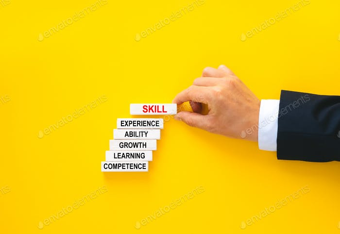 Skill text with keywords. Businessman building wooden blocks with skill concept.