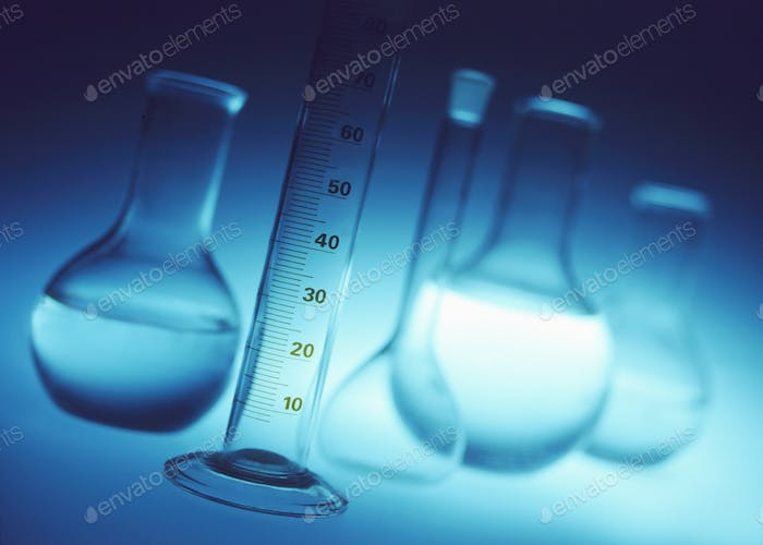 Chemical laboratory glassware - measuring cylinder, volumetric and chemical flasks.