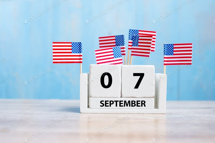 7 September of white Calendar with United States of America flag on wood background