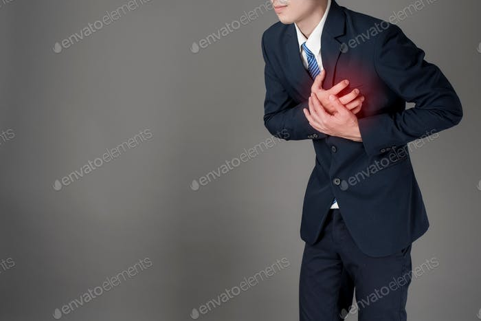 Business man is heart attacking