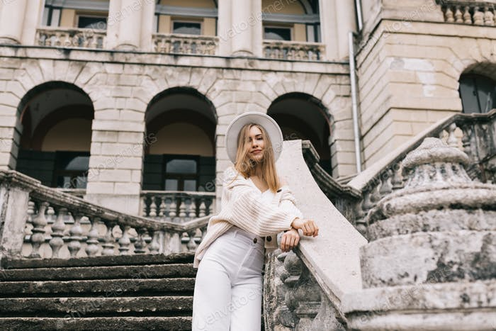 A pretty young woman tourist is traveling to places of interest abandoned buildings places and park