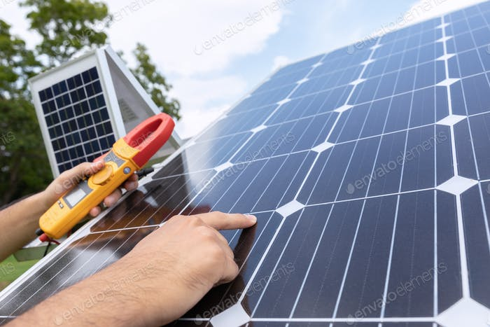 Engineer with energy measurement tool photovoltaic modules for renewable energy